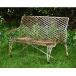 A light blue painted metal garden seat, possibly French