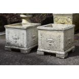 A pair of composition stone planters