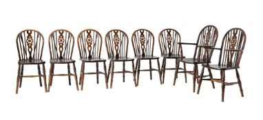 A set of eight beech and elm wheel back dining chairs