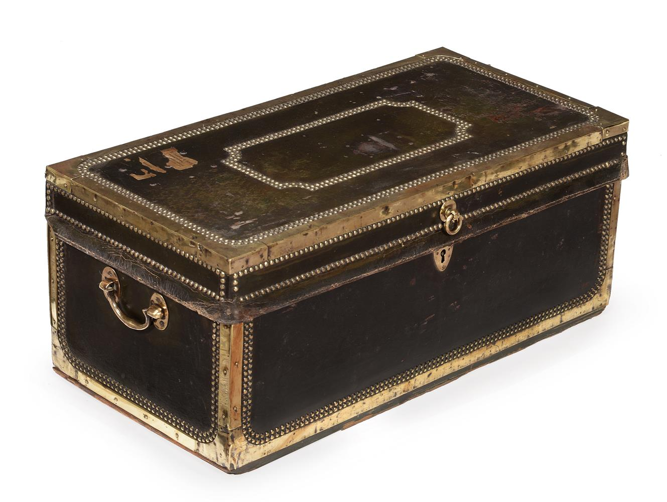 A studded leather and brass bound trunk