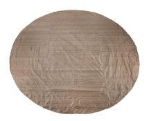 A circular metallic coloured silk table cover