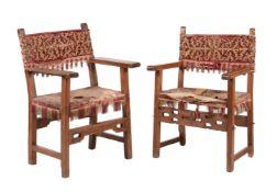 Two similar Iberian walnut open armchairs