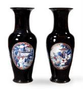 A large pair of Chinese black glazed baluster vases