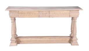 A limed hardwood console table in Continental 18th century style