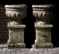 A pair of stone composition vases