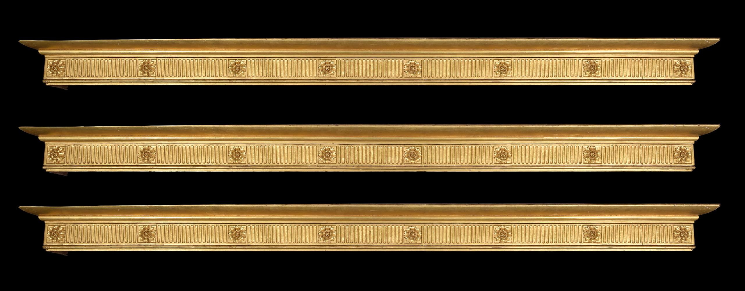 A set of three giltwood curtain pelmets, in George III style