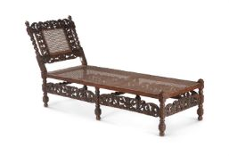 A carved oak day bed in Charles II style