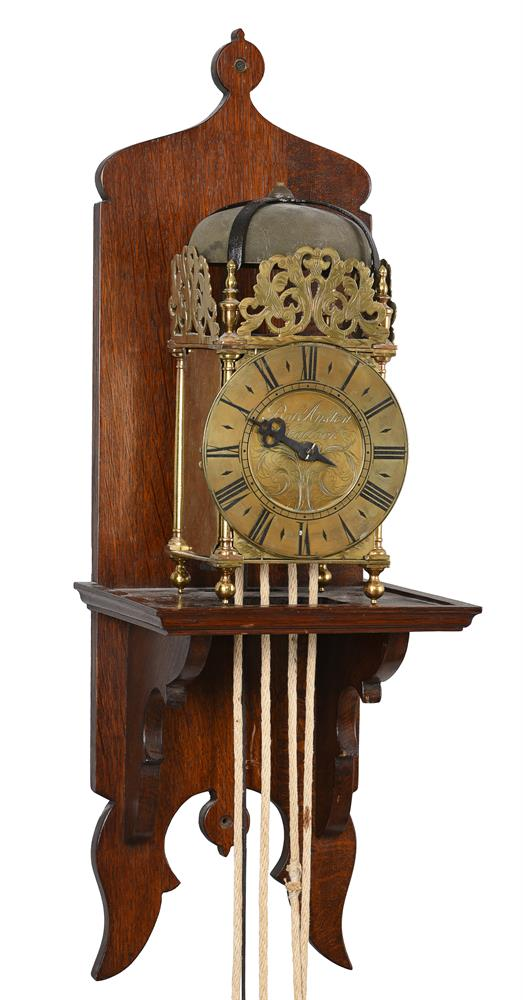 A George III brass lantern clock