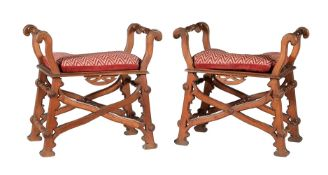 A pair of Reformed Gothic walnut X-framed stools or window seats