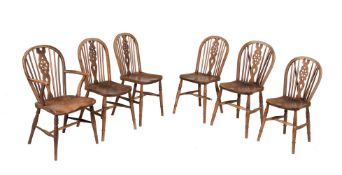 A set of six ash and elm wheel back Windsor chairs
