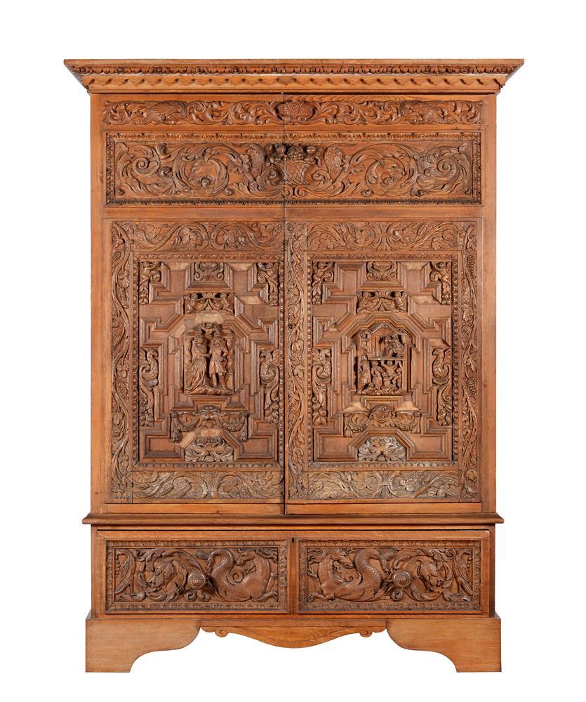 An oak and walnut press cupboard