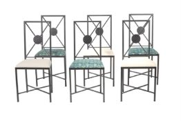A metal suite of dining furniture