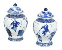 A pair of large Chinese blue and white jars and covers
