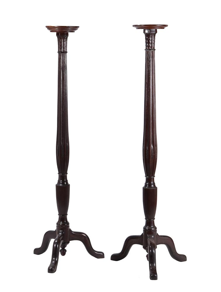A pair of mahogany torchere stands in George III style