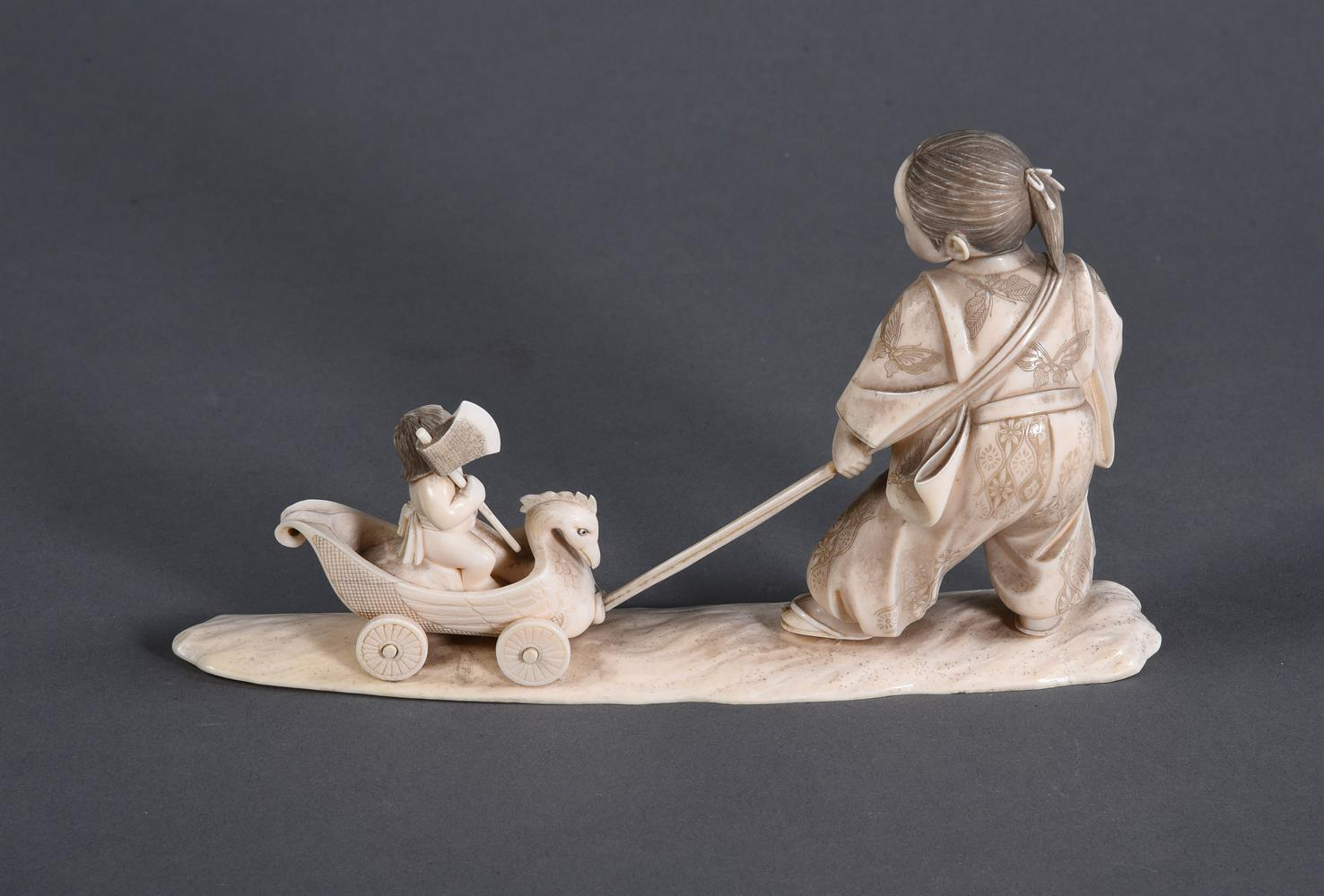 Y A Japanese Ivory Okimono of a young man standing on a shaped base - Image 4 of 4