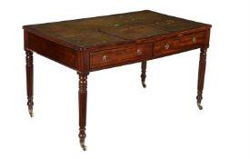 A Regency mahogany and ebony strung library or writing table