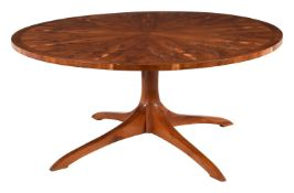 A yew circular dining table