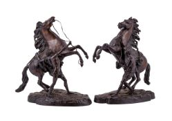 A pair of patinated Marly horses