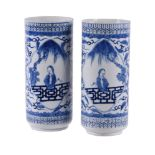 A pair of Chinese blue and white cylindrical vases