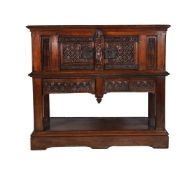 A carved oak hall cupboard