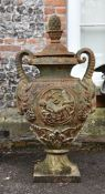 A cast iron urn and cover