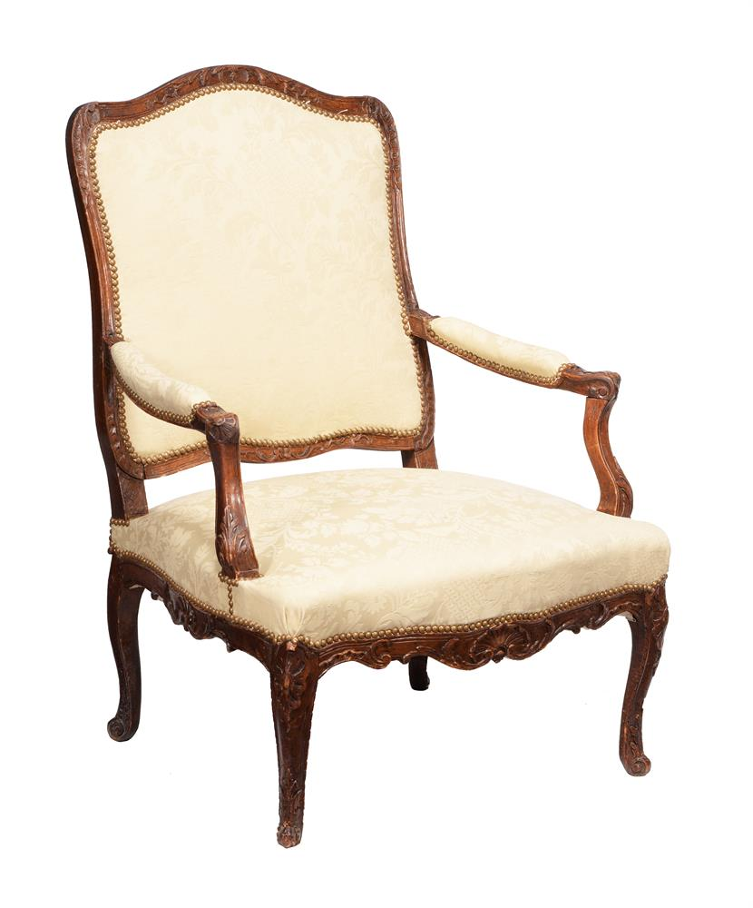 A French beech and upholstered armchair in Louis XV style
