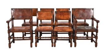 A set of eight oak and brass studded brown leather upholstered dining chairs