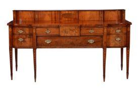 A George III mahogany and inlaid sideboard