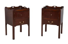 A pair of mahogany bedside tables in George III style