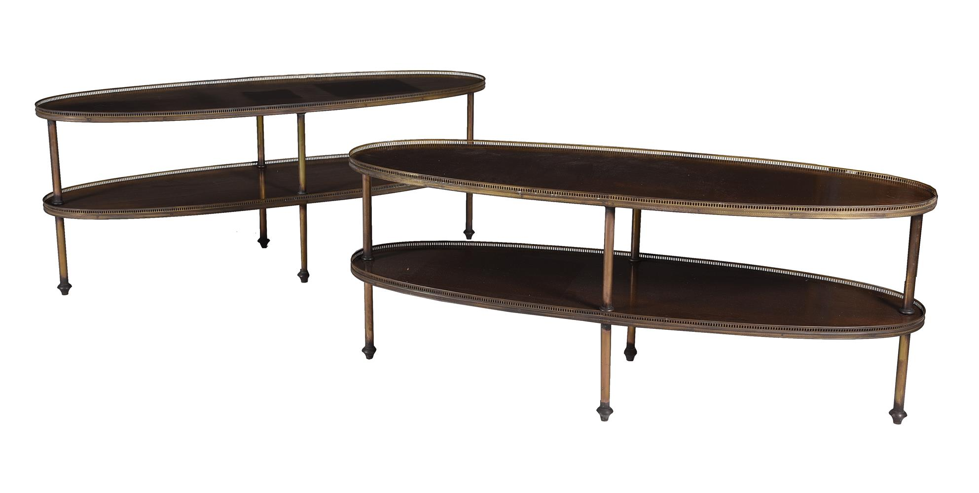 A pair of mahogany oval two tier side or occasional tables