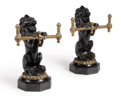 A pair of Victorian cast iron and brass fire dogs