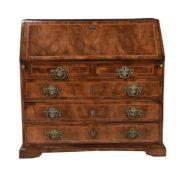 A Continental walnut and inlaid bureau