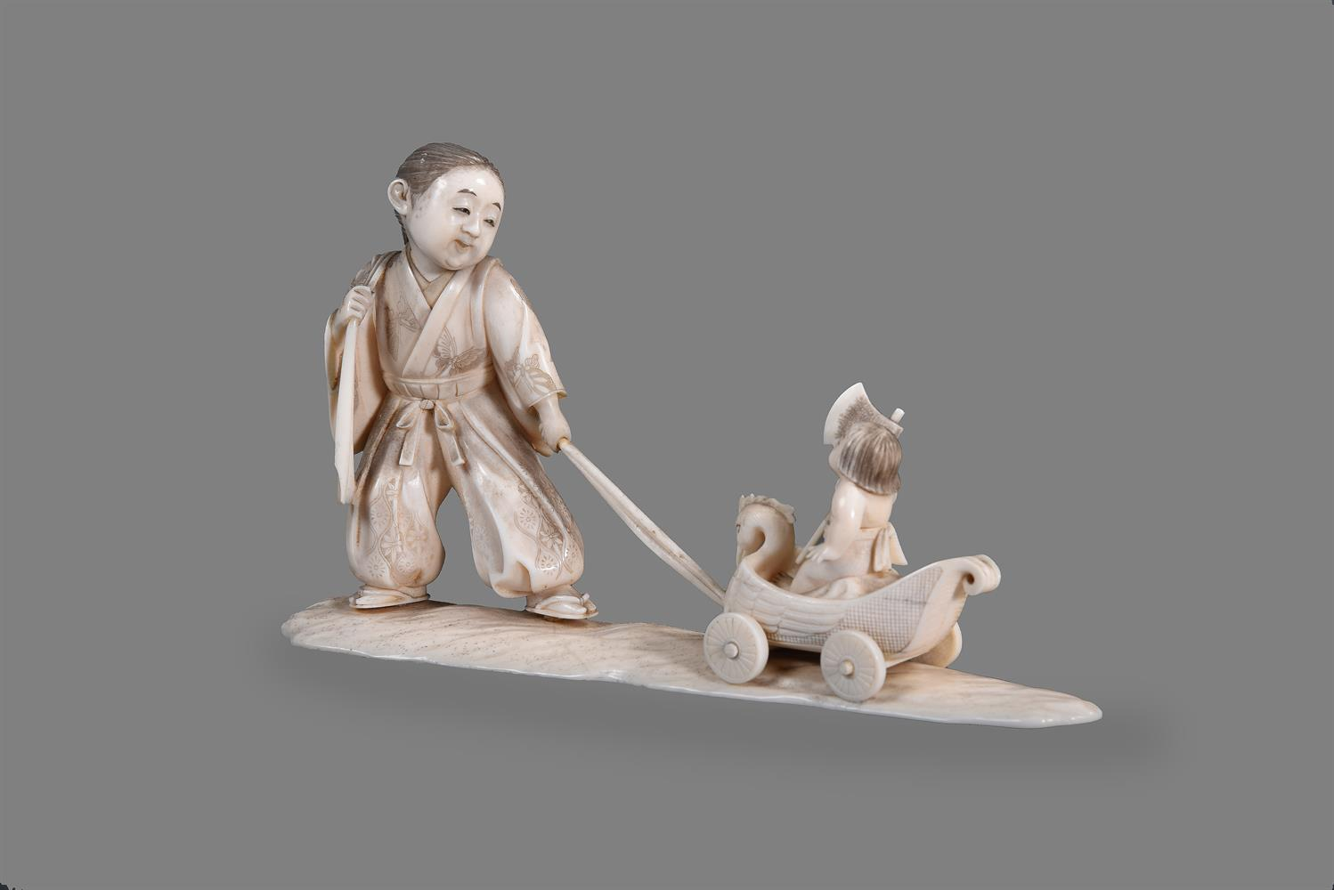 Y A Japanese Ivory Okimono of a young man standing on a shaped base - Image 2 of 4