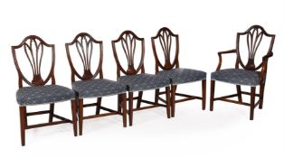 A set of eight George III dining chairs
