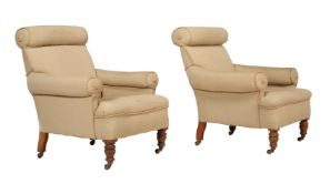 A pair of late Victorian oak and upholstered armchairs