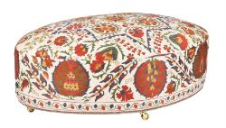 An oval Susani upholstered centre stool