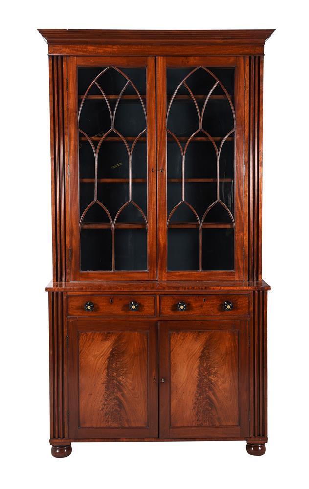 An early Victorian mahogany cabinet bookcase