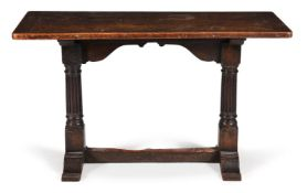 A carved oak tavern table