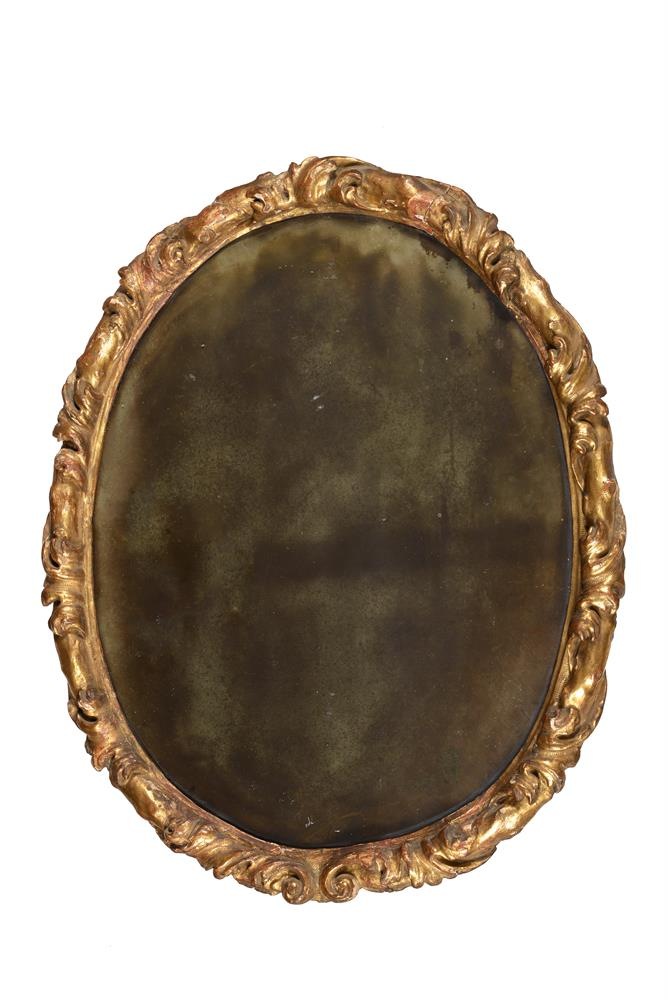 A Continental carved giltwood oval wall mirror
