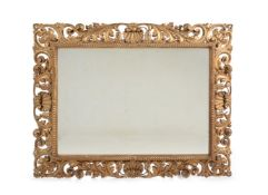 AN ITALIAN CARVED GILTWOOD WALL MIRROR, PROBABLY FLORENTINE, LATE 19TH CENTURY