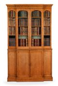 A GEORGE IV 'BIRD'S EYE' MAPLE BREAKFRONT LIBRARY BOOKCASE, CIRCA 1830