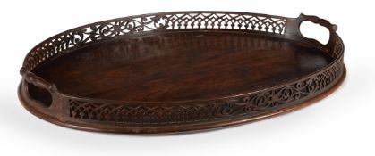 A GEORGE III MAHOGANY OVAL TRAY, IN THE MANNER OF THOMAS CHIPPENDALE, CIRCA 1770