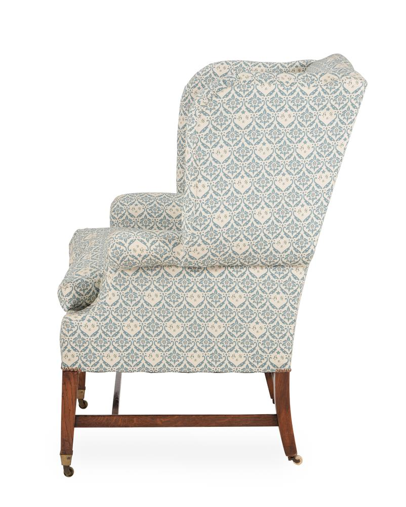 AN EDWARDIAN OAK, SIMULATED OAK AND UPHOLSTERED WING ARMCHAIR, EARLY 20TH CENTURY - Image 3 of 6