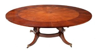 A MAHOGANY CONCENTRIC EXTENDING CIRCULAR DINING TABLE, IN GEORGE III STYLE