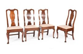 A CLOSELY MATCHED SET OF EIGHT GEORGE II 'RED WALNUT' DINING CHAIRS, CIRCA 1750