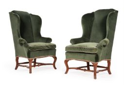 A PAIR OF WALNUT AND UPHOLSTERED WING ARMCHAIRS, IN WILLIAM & MARY STYLE