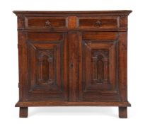 A CHARLES II OAK, FRUITWOOD AND SNAKEWOOD ENCLOSED CHEST OF DRAWERS, CIRCA 1670