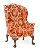 A GEORGE II MAHOGANY AND UPHOLSTERED WING ARMCHAIR, CIRCA 1740