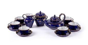 A SEVRES PORCELAIN BLEU LAPIS GROUND AND GILT TEA SERVICE IN THE SECOND EMPIRE STYLE