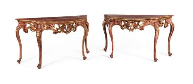 A PAIR OF CONTINENTAL RED PAINTED AND PARCEL GILT CONSOLE TABLES, SECOND HALF 18TH CENTURY